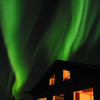 Credit: Mok Kumagai/Aurora Borealis Lodge<br /> <br /> The northern lights dance above the Aurora Borealis Lodge just north of Fairbanks.