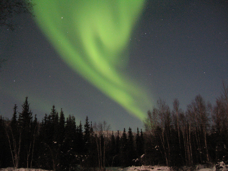 The aurora borealis lights up the night sky off Chena Hot Springs Road near Fairbanks, Alaska.