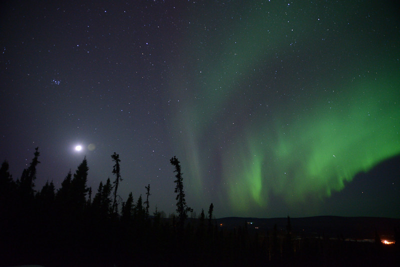Credit: Sherman Hogue/Explore Fairbanks<br /> <br /> Full moon and aurora near Fairbanks, Alaska.