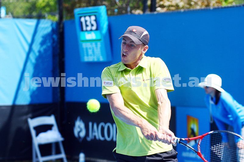 19-1-16. Australian Open 2016. Mens Round 1. Diego Schwartzman in action before he retired in his match against Australian John Millman while leading 2 sets to 1. Schwartzman went into severe cramps and had to be stretchered from the court. Photo: Peter Haskin