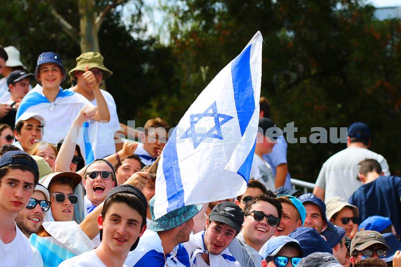 19-1-16. Australian Open 2016. Mens Round 1. Dudi Seli def Benjamin Becker (Ger) 6-2 6-3 2-6 6-2. Fans with flags. Photo: Peter Haskin
