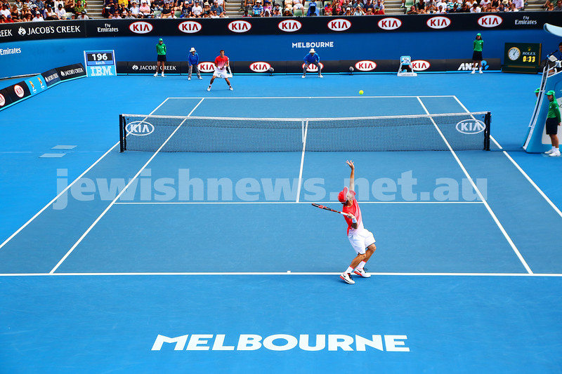 23-1-16. Australian Open 2016. Day 6. Mens Round 3. Andrey Kuznetsov (RUS) defeats Dudi Sela (ISR) 7-5 3-6 6-1 7-6(4). Dudi Sela serving. Photo: Peter Haskin