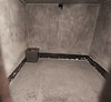 Solitary confinement room where prisoners were starved into submission or death.