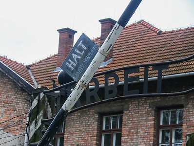 The sign over the entrance was stolen in 2009, but later recovered and the perpetrators prosecuted. As a result, this is a replica and the original is in a warehouse.