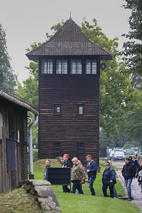 "One of nine perimeter guard towers. No longer in existence are two rings of guard towers outside the original walls of Auschwitz with ""shoot on site"" orders. Each ring contained electrified barbed wire and guard towers only 75 yards apart. The outer ring was many yards further out, meaning someone who wanted to dig a tunnel would need a very long one. 144 people escaped from here without being tracked down-the final fate of most of them is unknown."