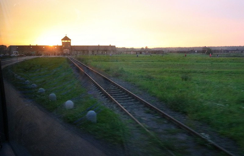 The train tracks into Birkinau Death Camp. Toward the end of the war continuous trains unloaded prisoners at the landings, took all their possessions and marched them directly to the gas chambers. This was a quick photo from the bus at a sharp backward angle without time to aim. As my friend Dave Billingsley observed, it seems fitting that the sun is setting directly over Birkinau, just as it did on the lives of so many here in WWII.