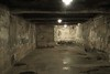 Interior of replica gas chamber. Being gassed to death was quite painful and slow if you did not get a strong whiff of the initial vapors, which would render you unconscious quickly. Testimony says one prisoner tried to commit suicide beforehand. The camp doctors saved him and treated him so he would last long enough to suffer the fate of being gassed with others.