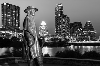 Downtown Austin B&W version with a statue of Stevie Ray Vaughn in the foreground.