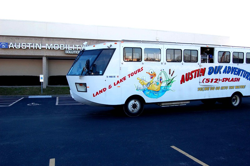 The giant Austin Duck Adventure tour vehicle, part bus and part boat, pulls up in front of Austin Mobility, 15301 N. IH-35, Pflugerville.