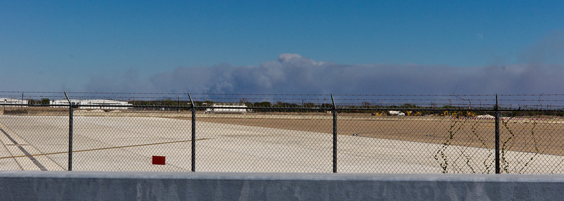 Smoke billowing from the Bastrop fire...taken from the Berstrom International Airport on 09-05-2011