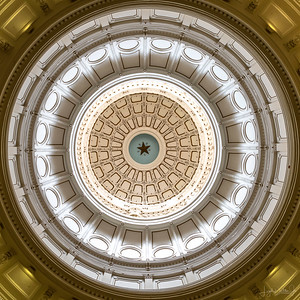 The Capitol Rotunda taken from directly below on the ground floor where the Texas State Seal is located.
