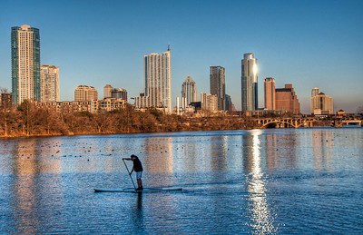 austin-skyline-river-board-paddler