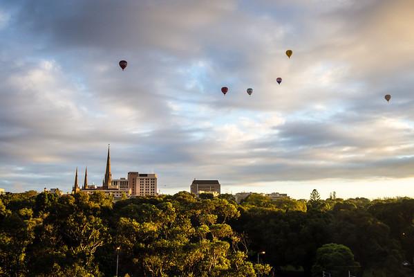 Hot air balloons usher in the sunrise over Melbourne, Australia.