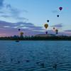 Balloons taking off at sunrise
