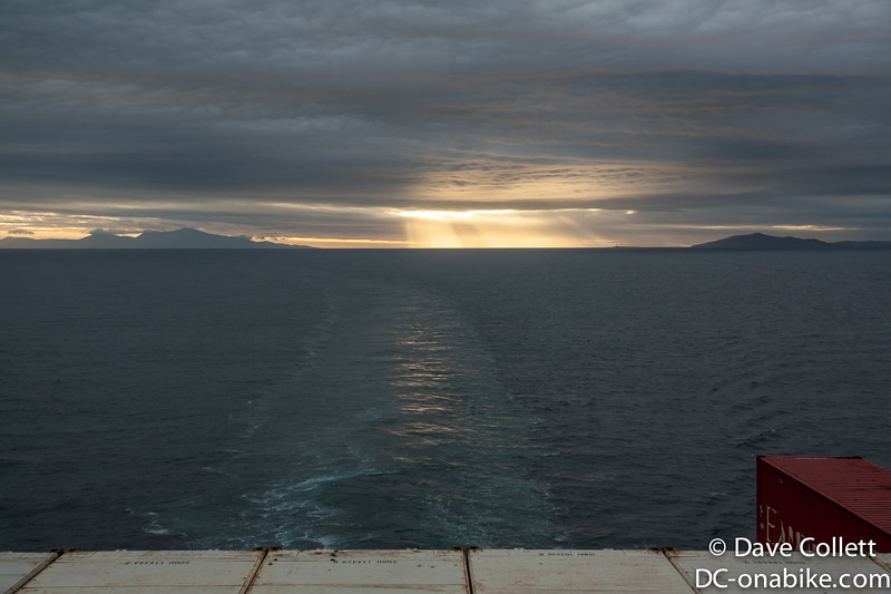 Looking back through Foveaux Strait. Rakiura to the left, Dog Island and Bluff Hill to the right.