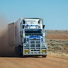 Back on the Track, we encountered our first road train.   You just plain get out of their way!