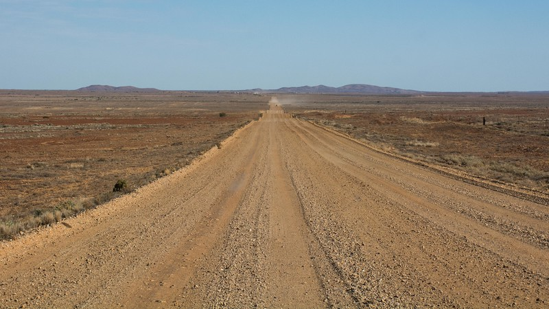 The road stretched out ahead of us as we reached and began our travels along the Oodnadatta Track.