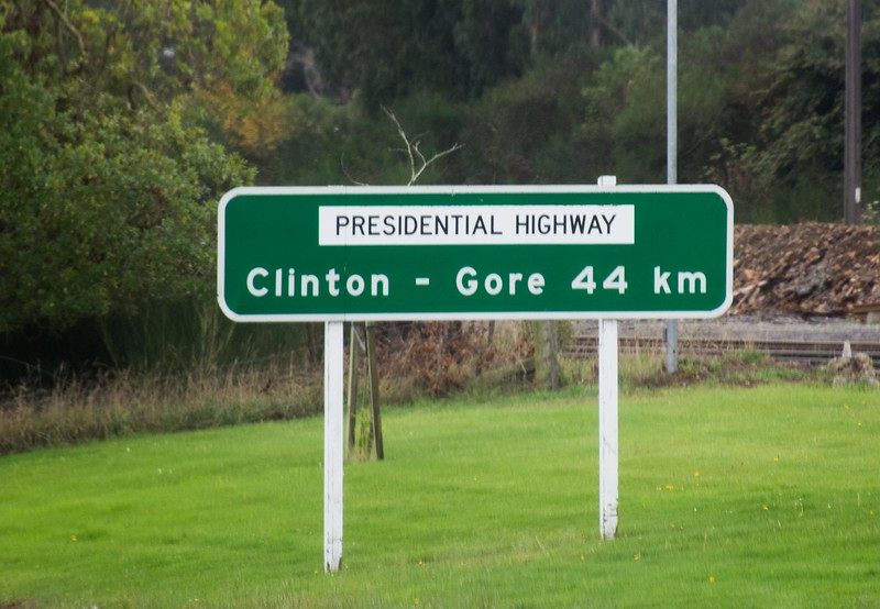 These are two real towns in South Island.  Gore is an especially nice place.  The Presidential Highway name was added in the 1990's, perhaps at a somewhat optimistic time.