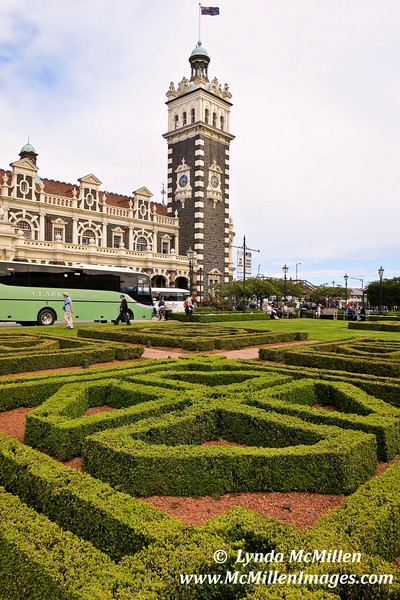 Dunedin Railway Station, built of dark basalt and Oamaru stone, began service in 1906.
