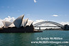 Iconic Opera House, Sydney Bridge and glimmering Sydney Harbor.