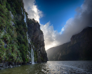 Dramatic steep cliffs and beautiful falls line the walls of Milford Sound