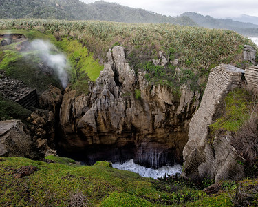 The steam rising at your left is spray from the blowhole as the  channel dramatically narrows at Punakaiki