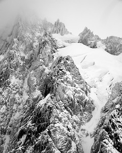 With the pale colors of the snow these dramatic rocks make an outstanding black and white print