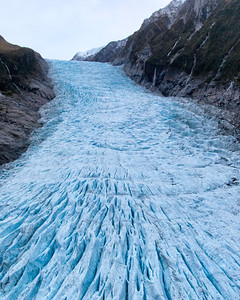 Fox Glacier is retreating rapidly and the only good way to see it is from a helicopter.  There are many operators in town offering rides