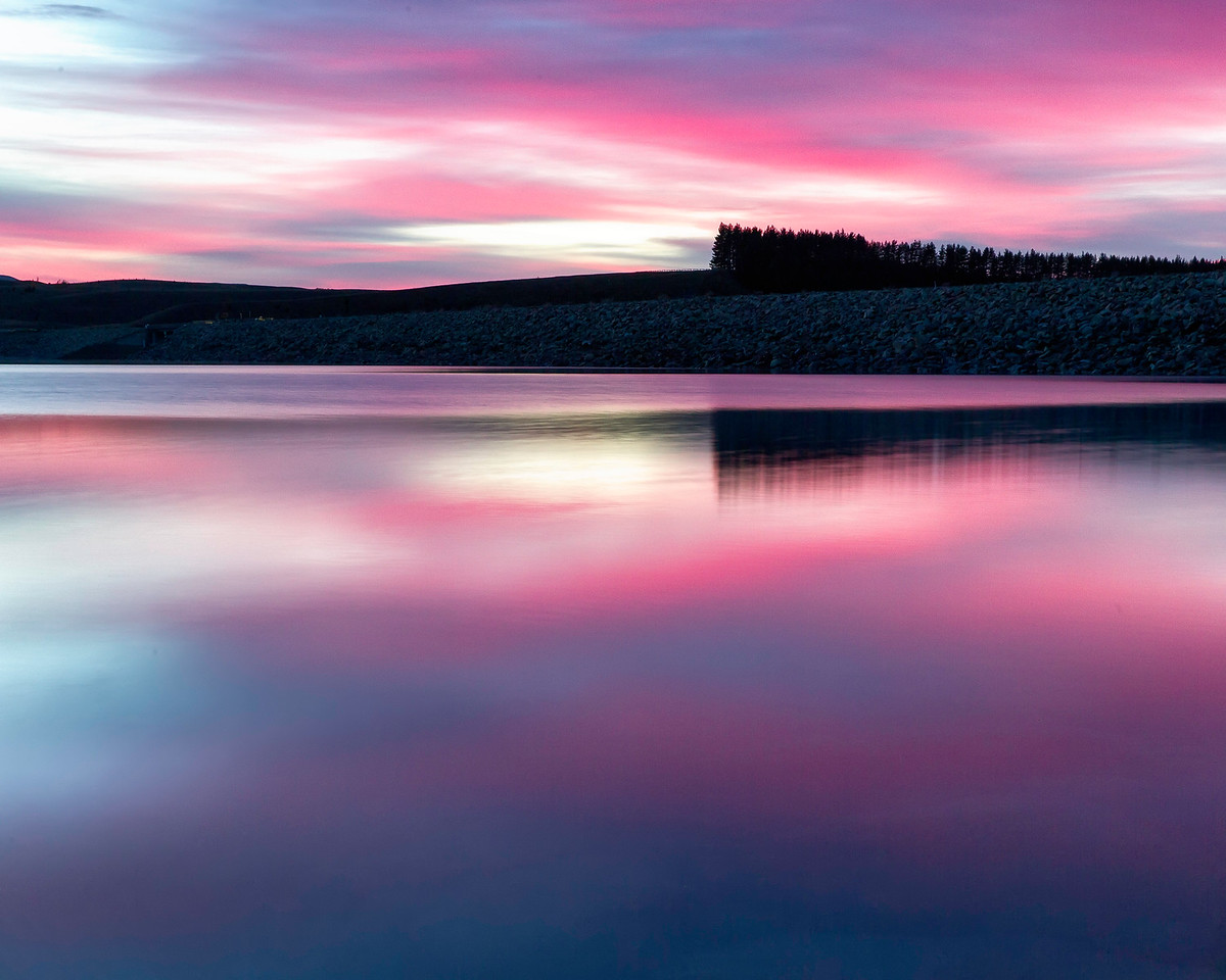 A beautiful sunrise reflected in the lake at Twizel