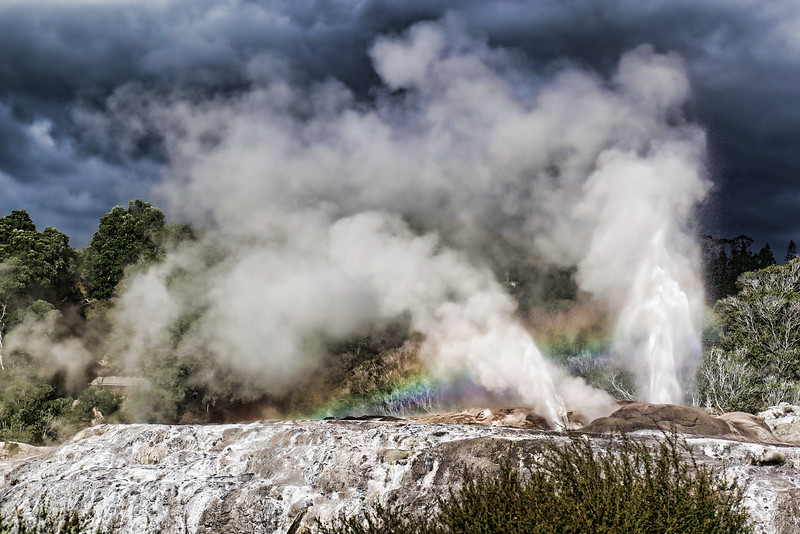 Geo-thermal geyser with rainbow, Rotoura, NZ