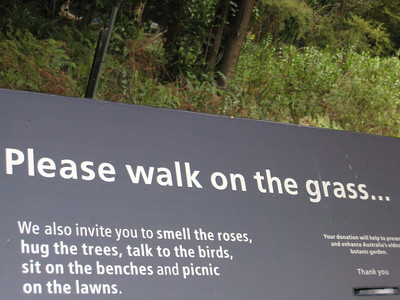 Sign at the Botanical Gardens in Sydney: Please walk on the grass