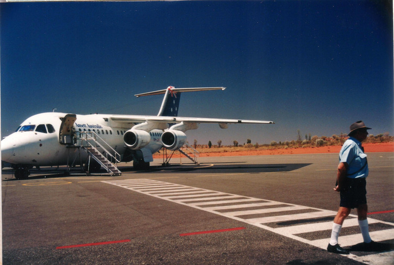 "Ayers Rock Airport (Connellan Airport) (AYQ) shown here in 1995,  is situated near Yulara, around 463 km (288 mi) (5 hrs drive) away from Alice Springs, Northern Territory, and 20 minutes drive from Uluru (Ayers Rock) : <a href=""http://ayersrockairport.com/map.html"">http://ayersrockairport.com/map.html</a><br /> <br /> We stayed a ""Sails-In-The-Desert""t; <a href=""http://www.ayersrockresort.com.au/sails/"">http://www.ayersrockresort.com.au/sails/</a>  We really enjoyed the hotel and used a rental car to get around as we wished and then drove to Alice Springs for our onward flight to Adelaide."