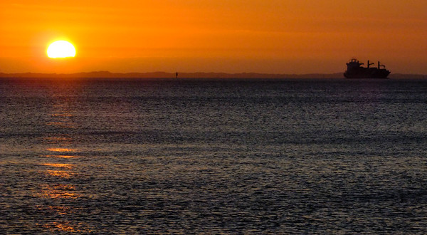 Sunset and ship, Port Philip Bay, Dromana, Mornington Peninsula, Victoria, Australia.