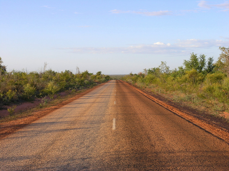 Cape Leveque Road - paved part. The lane returning from the Cape is tinted red by cars coming from...