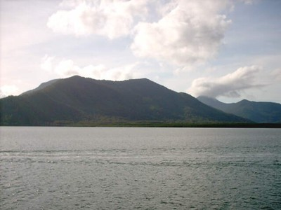 view of mountains around Cairns, from boat heading towards Michaelmas Cay