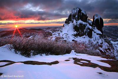 Last of the light flares across the snow bound rocks. The Cathedral, Mt Buffalo, Victoria.