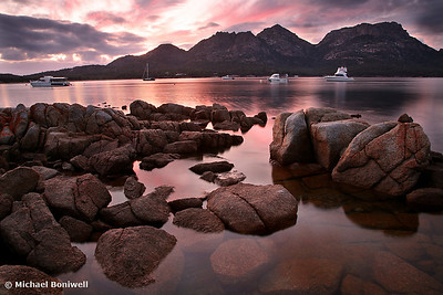 "A new day dawns over ""The Hazards"", Coles Bay, Tasmania."