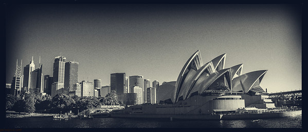 opera house with the city in the backdrop