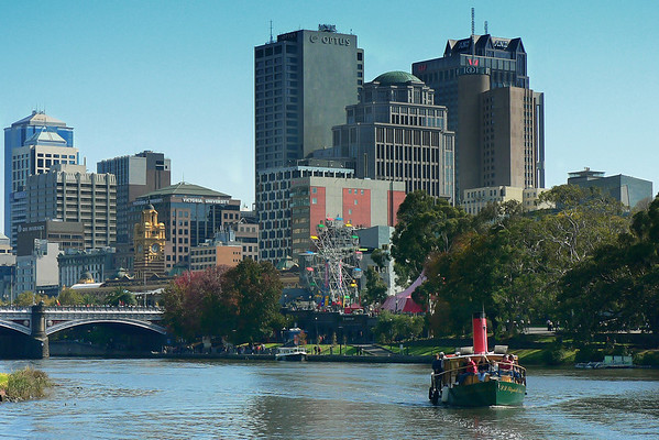 Princes Bridge, Flinders Street Station Clock Tower, and old cruise boat