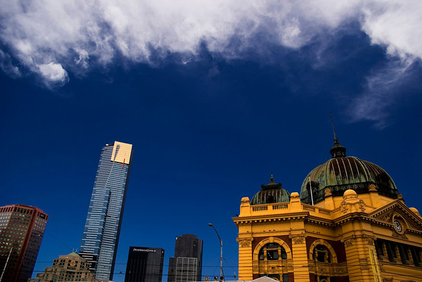 Flinders St Station and Eureka Tower. Taken just as the last clouds were clearing after a rainy early morning in Autumn.
