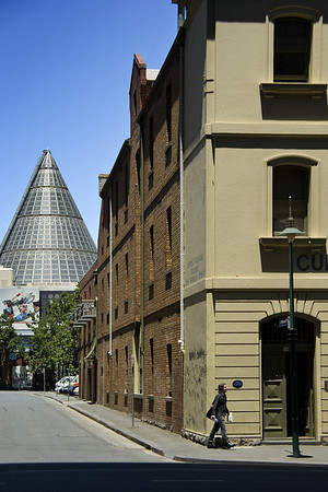 Stewart Street and the Cone.  The cone is part of the Melbourne Central shopping mall and houses an old lead shot tower, the destruction of which for the purposes of enhancing the shopping experience was vigorously opposed by the National Trust and other bodies concerned with the heritage of Melbourne.