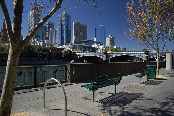 Southgate by Princes Bridge - Autumn in Melbourne. From this viewpoint you can see several Melbourne landmarks - the Flinders St station, St Paul's Cathedral, and the Federation Square buildings (the grey and pink jigsaw-like thing).