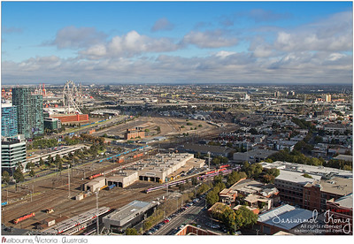 Bird view of West Melbourne with Bombardier tram depot and Star Observation Wheel in the foreground in Melbourne, Australia