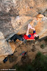 Adam Demmert fights the crux sequence on the FFA of Insha'Allah (27), Red Rocks, Grampians, Victoria, Australia