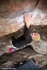 Brad bouldering V3 mini-cave at Loopy's, Grampians, Victoria, Australia
