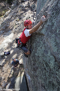 Michael Totterdel attempting the first ascent of Carpal Tunnel (23), Mt Alexander, Victoria, Australia