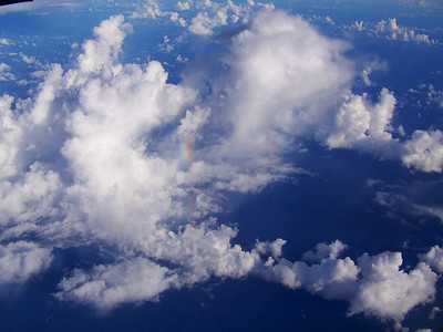 clouds and rainbow seen from plane, somewhere over the Pacific