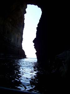 view through arch in cliffs, Tasman National Park
