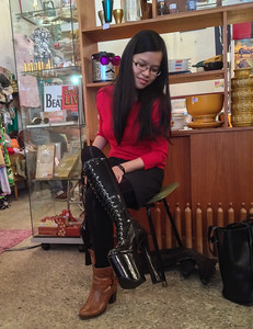 Quynh considers whether these 6-inch heels would fit in our return luggage.