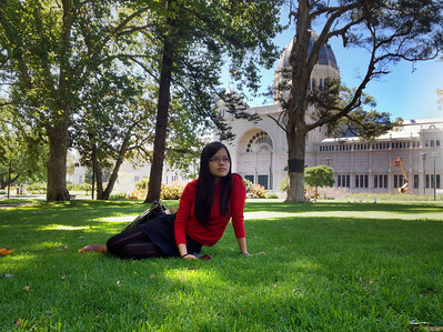 Quynh rests on the soft grass in Carlton Gardens